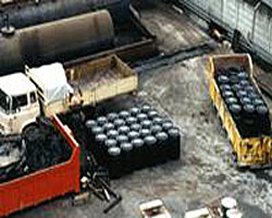 Hazardous chemicals for encapsulation disposal.Receiving drums prepared for dispatch.