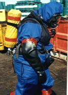 "Dave Marock dressed in a ""B"" chemical suit prior to assessing damage to toxic materials."